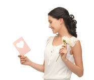 http://www.dreamstime.com/royalty-free-stock-photo-young-woman-holding-flower-postcard-image38316865