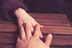 http://www.dreamstime.com/royalty-free-stock-image-couple-s-hands-table-young-touching-image38521666