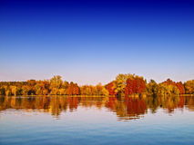 http://www.dreamstime.com/stock-photos-autumn-lake-scenery-image23247673